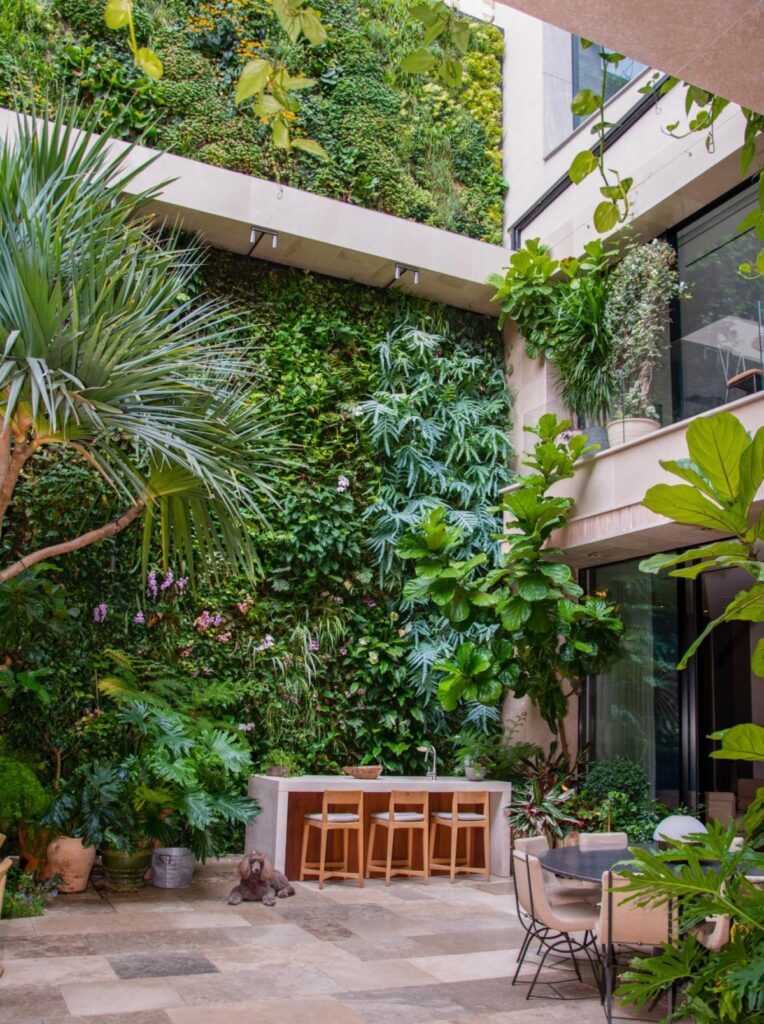 The indoor living wall transitions into the outdoor facade